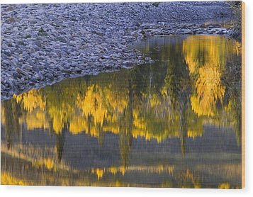Water Reflections With A Rocky Shoreline Wood Print by Carson Ganci