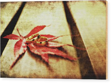 Wedding Rings On Red Wood Print by Meirion Matthias