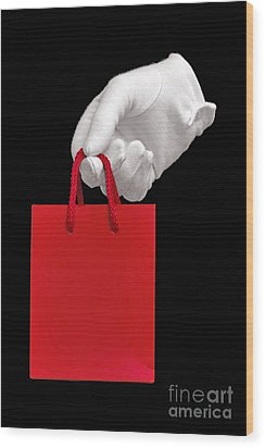 White Glove Holding A Red Gift Bag Wood Print by Richard Thomas