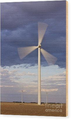 Wind Turbine Spinning At Dusk Wood Print by Jeremy Woodhouse