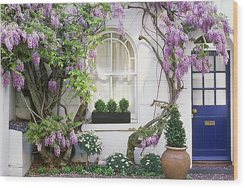 Wisteria Climbing Up Wall Of House With Window Box Wood Print by Linda Burgess