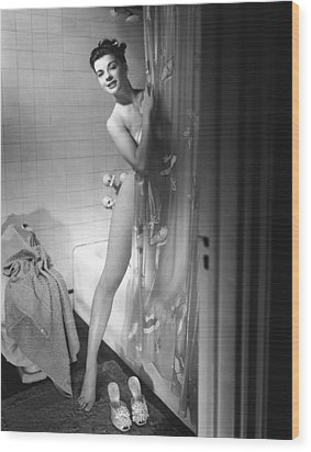 Woman Behind Shower Curtain Wood Print by George Marks