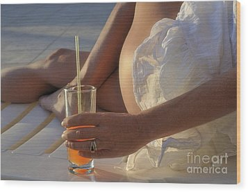 Woman Holding Cocktail Glass While Sunbathing Wood Print by Sami Sarkis