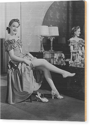 Woman Sitting At Vanity Table, Putting On Stockings, (b&w), Portrait Wood Print by George Marks