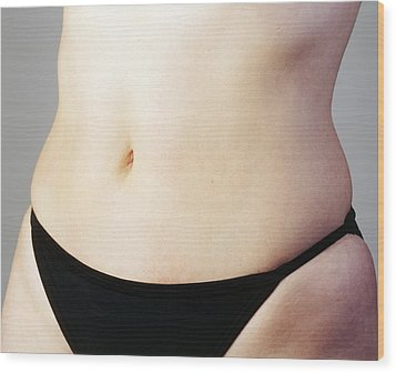 Woman's Naked Abdomen Wood Print by Carlos Dominguez