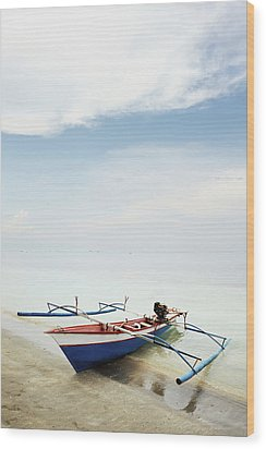 Wooden Outrigger Boat On Shore Wood Print by Carlina Teteris