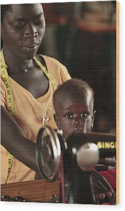 Working Mother And Child, Uganda Wood Print by Mauro Fermariello