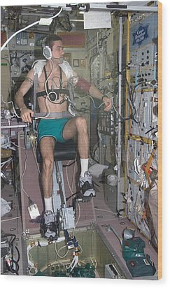 Working Out In Space. Cosmonaut Yuri Wood Print by Everett