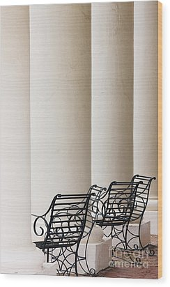 Wrought Iron Chairs And Columns Wood Print by Jeremy Woodhouse