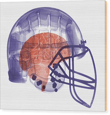 X-ray Of Head In Football Helmet Wood Print by Ted Kinsman