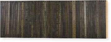 Yardsticks - Aged 18 Inch Wood Print by Kurt Olson
