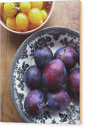 Yellow Cherry Tomatoes And Plums Wood Print by Laura Johansen