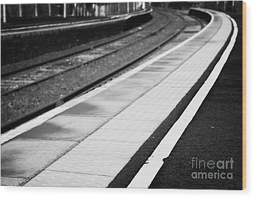 Yellow Warning Line And Textured Contoured Tiles Railway Station Platform And Track Northern Ireland Wood Print by Joe Fox