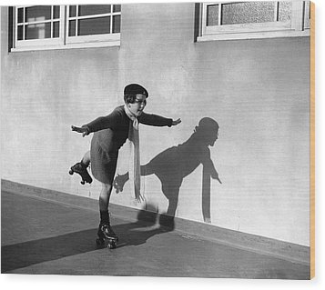 Young Girl (7-9) On Rollerskates (b&w) Wood Print by Hulton Archive