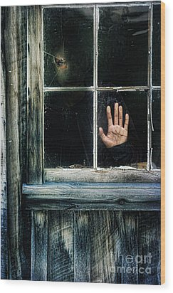 Young Woman Looking Through Hole In Window Wood Print by Jill Battaglia