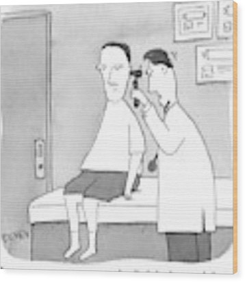 A Man Looks Inside A Patient's Ear Wood Print by Peter C. Vey