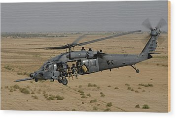 A U.s. Air Force Hh-60 Pavehawk Flies Wood Print by Stocktrek Images