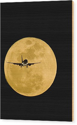 Aeroplane Silhouetted Against A Full Moon Wood Print by David Nunuk