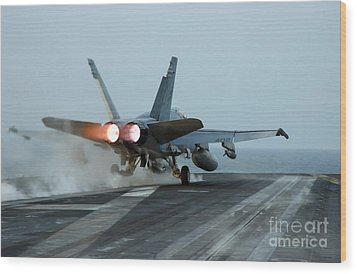 An Fa-18 Hornet Launches Wood Print by Stocktrek Images