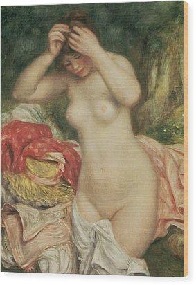 Bather Arranging Her Hair Wood Print by Pierre Auguste Renoir