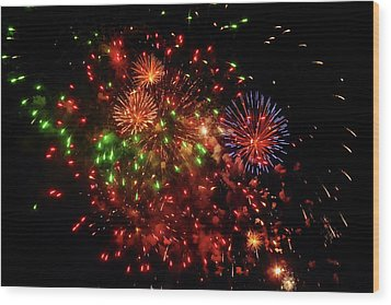 Beautiful Fireworks Against The Black Sky Of The New Year Wood Print