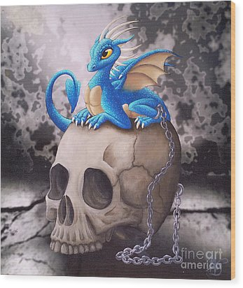 Captive Dragon On An Old Skull Wood Print