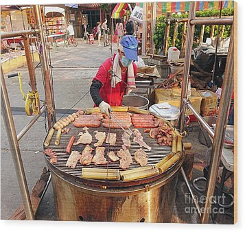 Wood Print featuring the photograph Cooking Meat And Eggs On A Huge Grill by Yali Shi