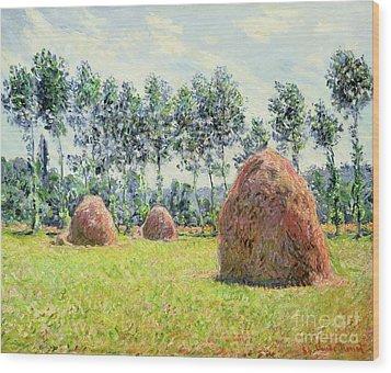 Haystacks At Giverny Wood Print by Claude Monet