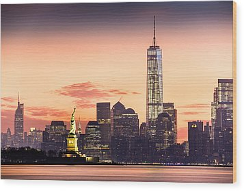 Lower Manhattan And The Statue Of Liberty At Sunrise Wood Print