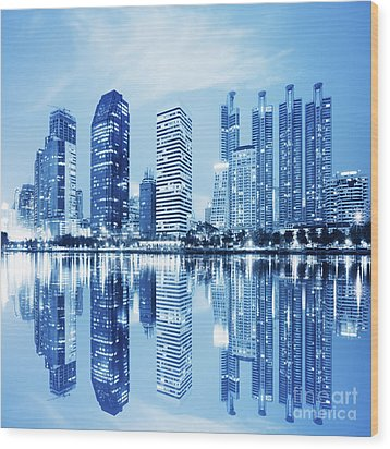 Wood Print featuring the photograph Night Scenes Of City by Setsiri Silapasuwanchai