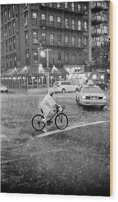 Wood Print featuring the photograph Rider In The Rain by Dave Beckerman