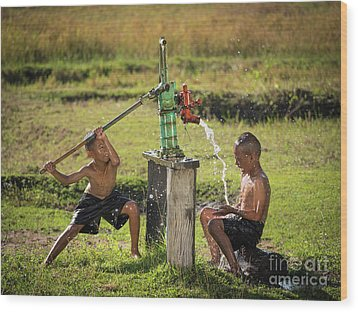 Wood Print featuring the photograph Two Young Boy Rocking Groundwater Bathe In The Hot Days. by Tosporn Preede