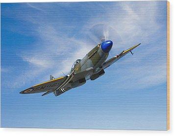 A Supermarine Spitfire Mk-18 In Flight Wood Print by Scott Germain