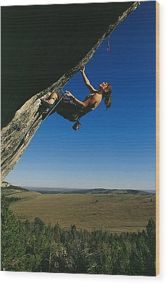 A Young Woman Climbing The Rock Feature Wood Print by Bobby Model