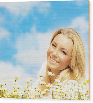 Beautiful Woman Enjoying Daisy Field And Blue Sky Wood Print