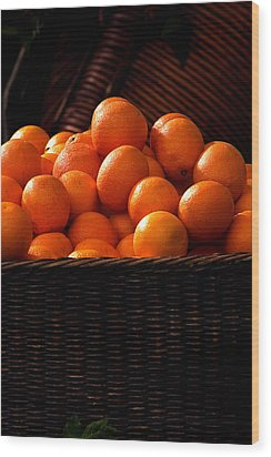 oranges in basket Rome italy Wood Print by Xavier Cardell