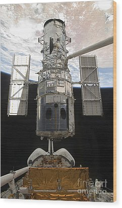 The Hubble Space Telescope Is Released Wood Print by Stocktrek Images
