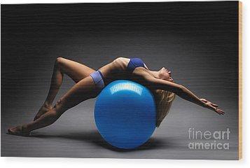 Woman On A Ball Wood Print by Oleksiy Maksymenko