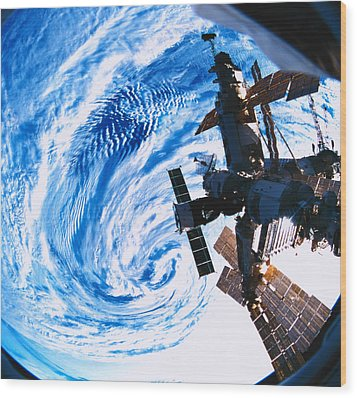 A Space Station Orbiting Above Earth Wood Print by Stockbyte