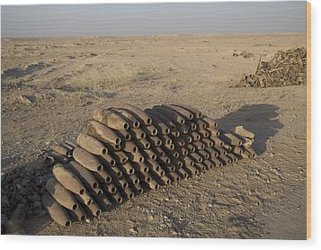 Inert Artillery Shells Are Stacked Wood Print by Terry Moore