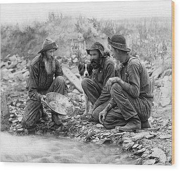 3 Men And A Dog Panning For Gold C. 1889 Wood Print by Daniel Hagerman