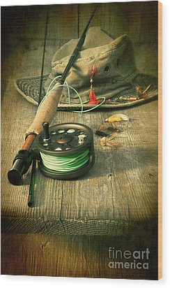 Fly Fishing Equipment With Old Hat On Bench Wood Print