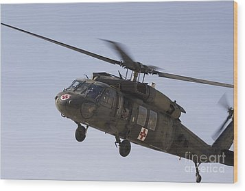 A Uh-60 Blackhawk Medivac Helicopter Wood Print by Terry Moore
