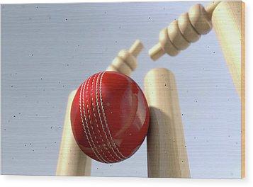 Cricket Ball Hitting Wickets Wood Print