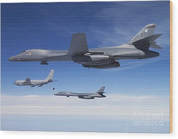 A B-1b Lancer Stands By As Another Wood Print by Stocktrek Images