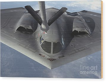 A B-2 Spirit Bomber Prepares To Refuel Wood Print by Stocktrek Images