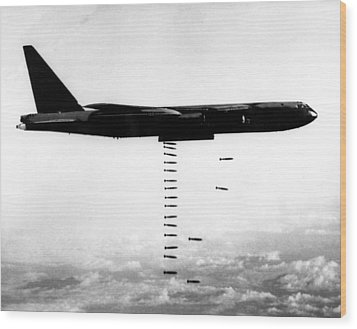 A B-52 Stratofortress Releases Bombs Wood Print by Everett