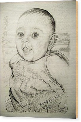 A Baby Smile Wood Print by Wale Adeoye