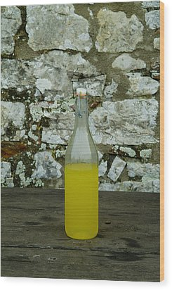 A Bottle Of Limoncello Sits On A Picnic Wood Print by Todd Gipstein