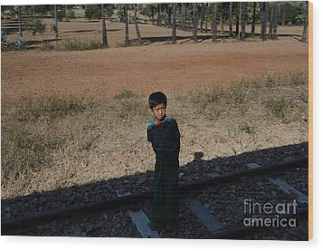 Wood Print featuring the photograph A Boy In Burma Looks Towards A Train From The Shadows by Jason Rosette
